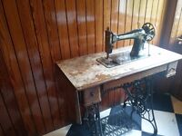 Antique Singer Sewing Machine with integrated table and pedal