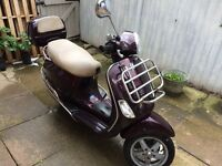 Classic Vespa scooter, modern features: heated handlebars, top box, top condition, only 2 owners