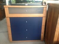 Chest of 4 drawers, navy blue front and top drawer is glass.