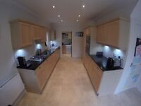 Kitchen complete with appliances and black granite worktops