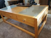 Wooden coffee table with 3 drawers and frosted glass top
