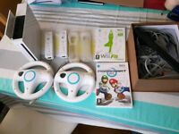 Wii games and controllers and console
