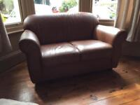 Leather effect brown sofa 2 seater