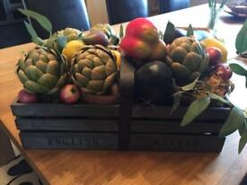 Trug with artificial fruit