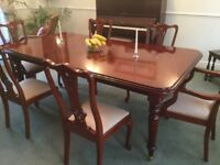 Large dining room table with removable middle leaf and six chairs