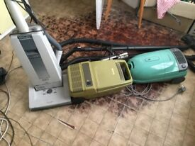 THREE VACUUM CLEANERS AND ACCESSORIES