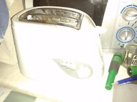White Asda Toaster. Good quality. Good condition. Works well. Several functions. Bargain