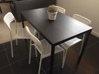 Dining table (110x67cms) and 4 chairs
