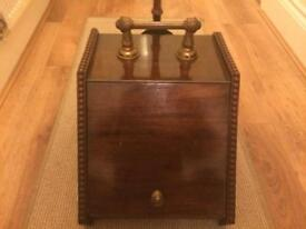 Antique wooden coal scuttle and brass fire companion