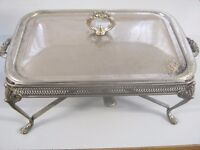 Silver plated food serving dish with burner below