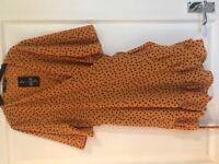 Quiz orange and black polka dot dress