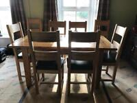 Solid oak extending dining table & 8 chairs