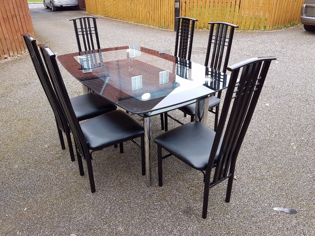Harveys Boat Glass Dining Table 6 Black Metal Chairs Free Delivery 0472