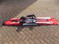 Adult Skis including Bindings, Poles and Ski Bag.