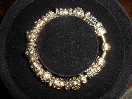 Pandora 14k Gold Bracelet 19cm and 27 14k gold charms 73.2g Farnborough Yeppoon Area Preview