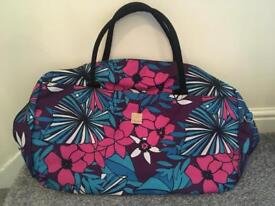Tripp bright coloured large hand luggage bag