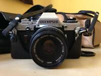 Olympus OM10 with accessories and bag