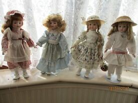 Four collectors dolls