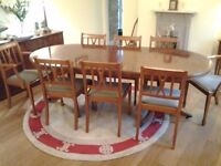 Yew Dining Table and 8 Chairs (2 Carvers) in excellent condition. Oval table has movable centre.
