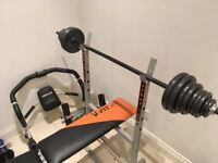 Gym equipment inc bench, bar, weights and more