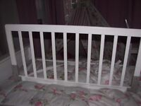 White wooden safety bed rail