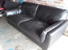 Black leather sofa. £15.00. (item is in Penicuik)