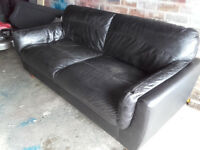 Black leather sofa. £15.00. (item is in Penicuik)