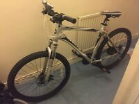 Giant bike has disc brakes and also front suspension silver new tires