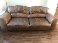 Brown leather sofa, chair and pouffe