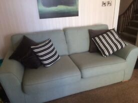 Sage green sofa one year old three seater L 200cm availablw for collection ant time