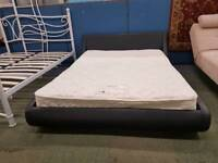 Black leather double bed frame with double myers mattress