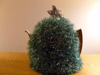 Hand knitted Tinsel tea cosy with diamantes on star at top