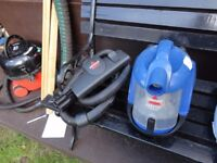 small blue bissell hoover compact working