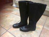 Clarke's black boots