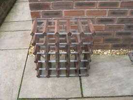A metal framed and wood wine rack.