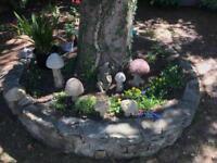 Six hand carved stone mushrooms