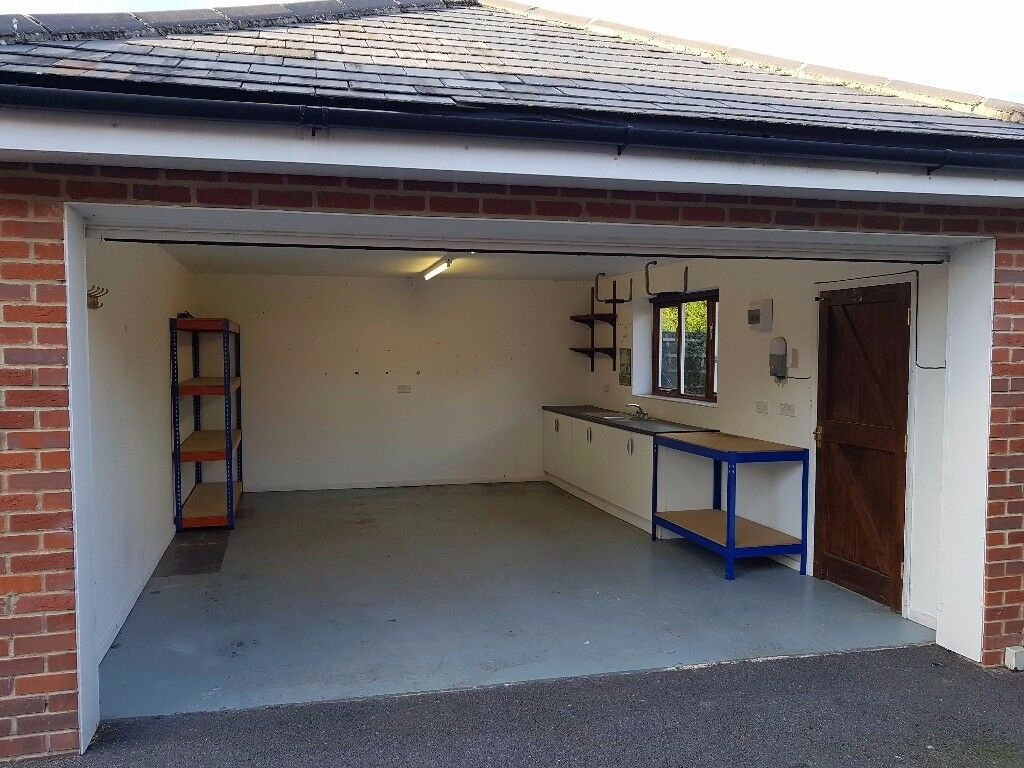 secure double garage workshop unit for rent with power