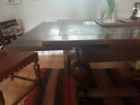 Aged oak dining table and chairs with matching decorative sideboard and nest of tables