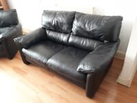Sofas in black leather , 2 x 2 two seatets