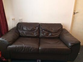 2x two seater brown leather sofa's