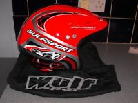 Wulfsport motorbike /motocross helmet in red and black with quick release chin strap.