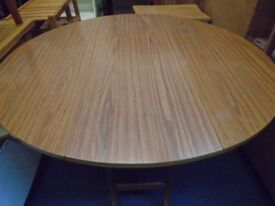 large round drop leaf table.