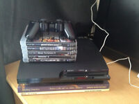 Playstation 3 with 5 Games.