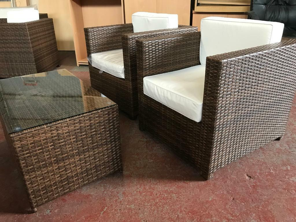 The chelsea rattan garden set consists of 2 armchairs with cushions and a coffee table