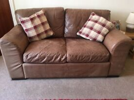Two seater rustic leather sofa