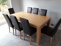 Dining table with 8 chairs from NEXT. Excellent condition (chairs have fire labels attached)