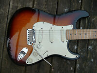 Fender Strat Plus Deluxe, with case. Can post.
