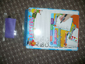 New dry erase activity book, learning letters, numbers and shapes. Christmas..