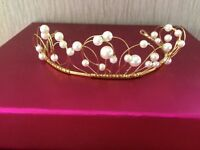 Beautiful unworn gold tiara with pearls.