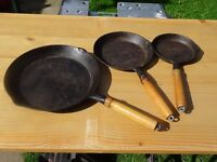 three cast iron frying pans -cast iron skillets